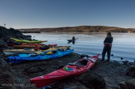 Boats loaded with camping gear. Ready to launch.