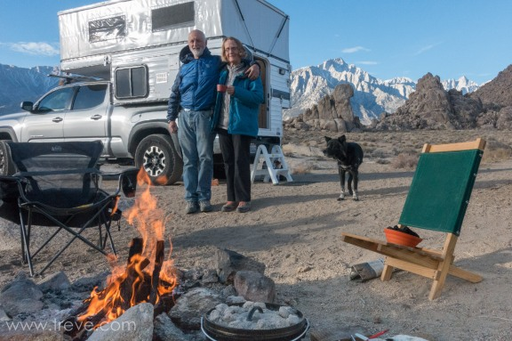 Treve, Joann and Carson at camp in the Alabama Hills. Breakfast of Quiche cooking in the Diutch Oven.