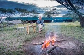 Joann enjoying the campfire at Seronera Sametu Camp