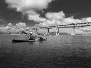 Kayakers approachint the Richmond San Rafael Bridge. BASK Thursday Paddle on April 12, 2018